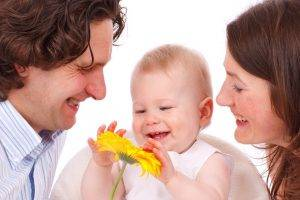 family-caucasian-flower-mom-dad-baby