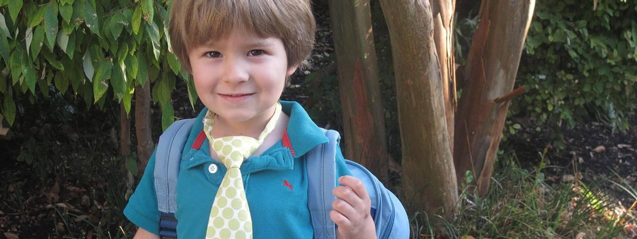 school boy with tie, happy after eye exam for kids in Oakville Ontario