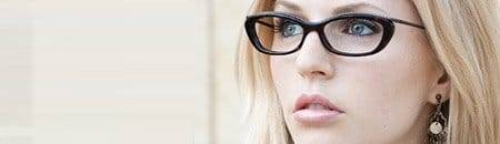 person looking serious designer eyewear frames