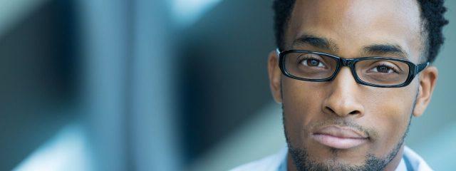 Eye doctor, man wearing eyeglasses in Lake Mary & Orlando, FL