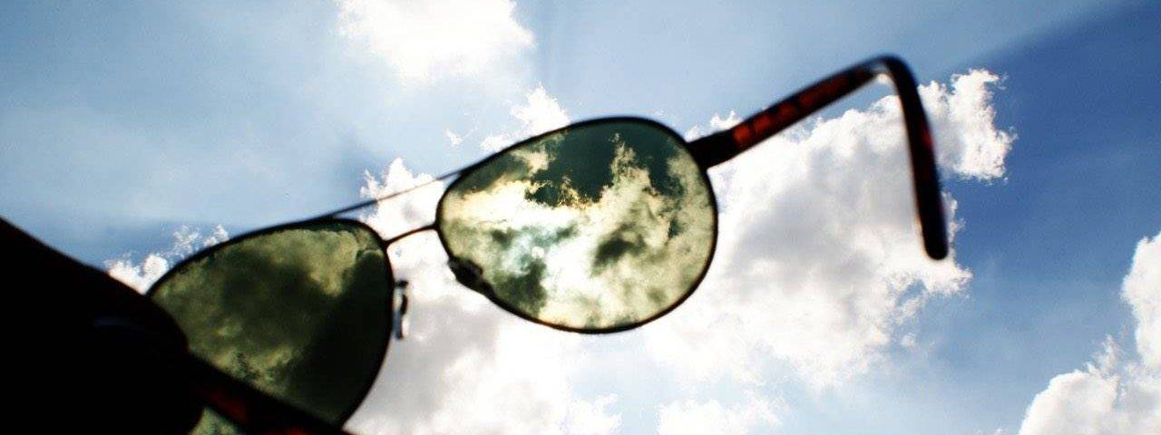 Eye doctor, woman playing golf with sunglasses in Lake Mary & Orlando, FL