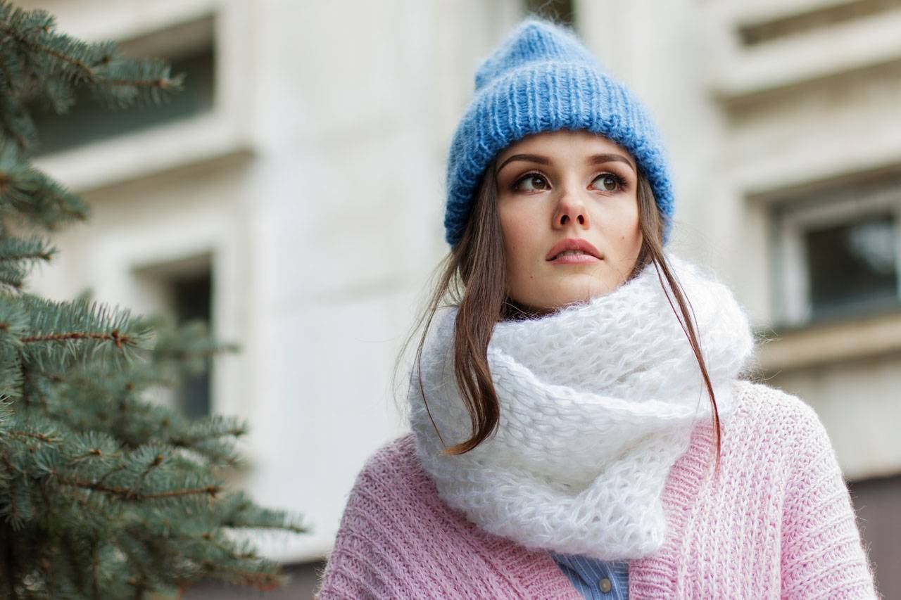 Girl wearing blue woolen hat