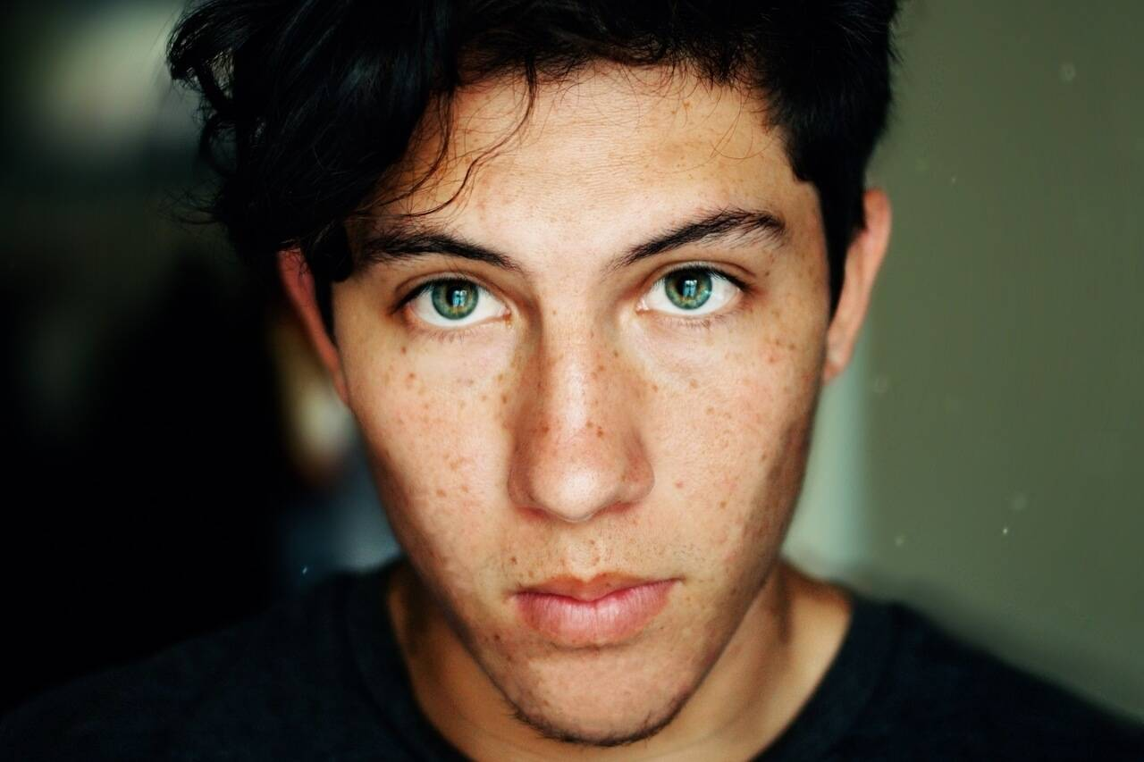 Boy, green eyes, freckles