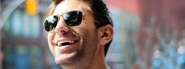 Eye care, man smiling wearing sunglasses in Katy, TX