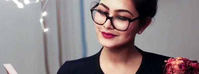 Eye care, woman wearing reading glasses in Katy, TX