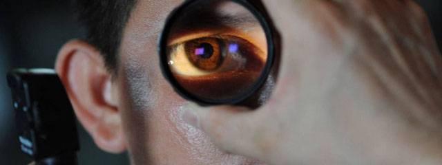 Eye doctor, doctor examining man's eye in West Lebanon, NH