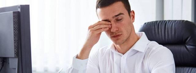 Optometrist, man rubbing his eyes in West Lebanon, NH