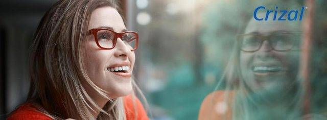 Optometrist, woman wearing Crizal lens eyeglasses in Fort Lauderdale, FL