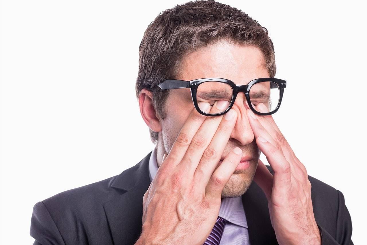 Eye doctor, man rubbing his eyes with eye allergies in Delaware, OH
