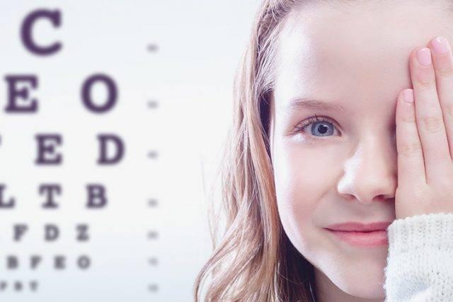 Optometrist, girl at eye exam in Houston, Texas