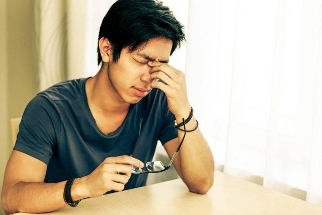 Eye doctor, asian man suffering from dry eyes in Houston, Texas