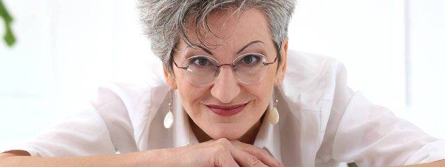 Optometrist, middle aged woman smiling in Louisville, LaGrange & Carrollton, Kentucky