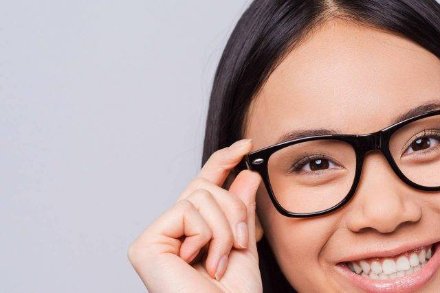 asian girl 20s happy eyewear close up 640x427