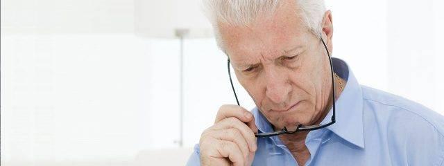 Optometrist, senior man having difficulties reading in Louisville, LaGrange & Carrollton, Kentucky