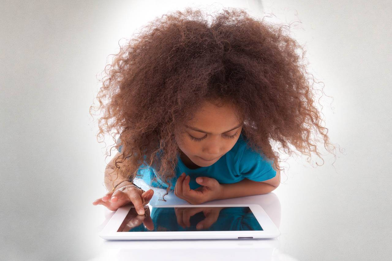 child using iPad, prevent digital eyestrain in Columbia SC