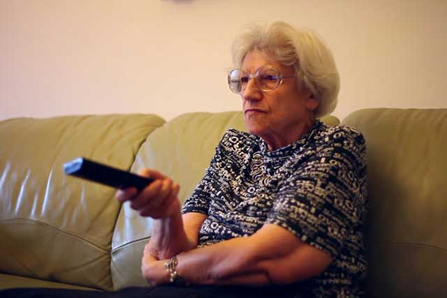 Woman Watching TV With Macular Degeneration