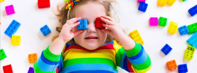 Eye doctor,  little girl with blocks of lego on her eyes in Lombard, IL