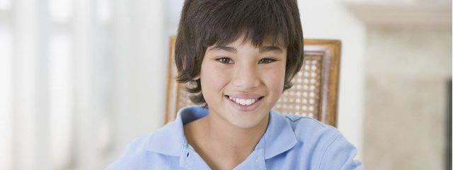 Optometrist, asian boy smiling in Walla Walla, Washington