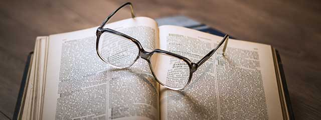 Pair of glasses on a book