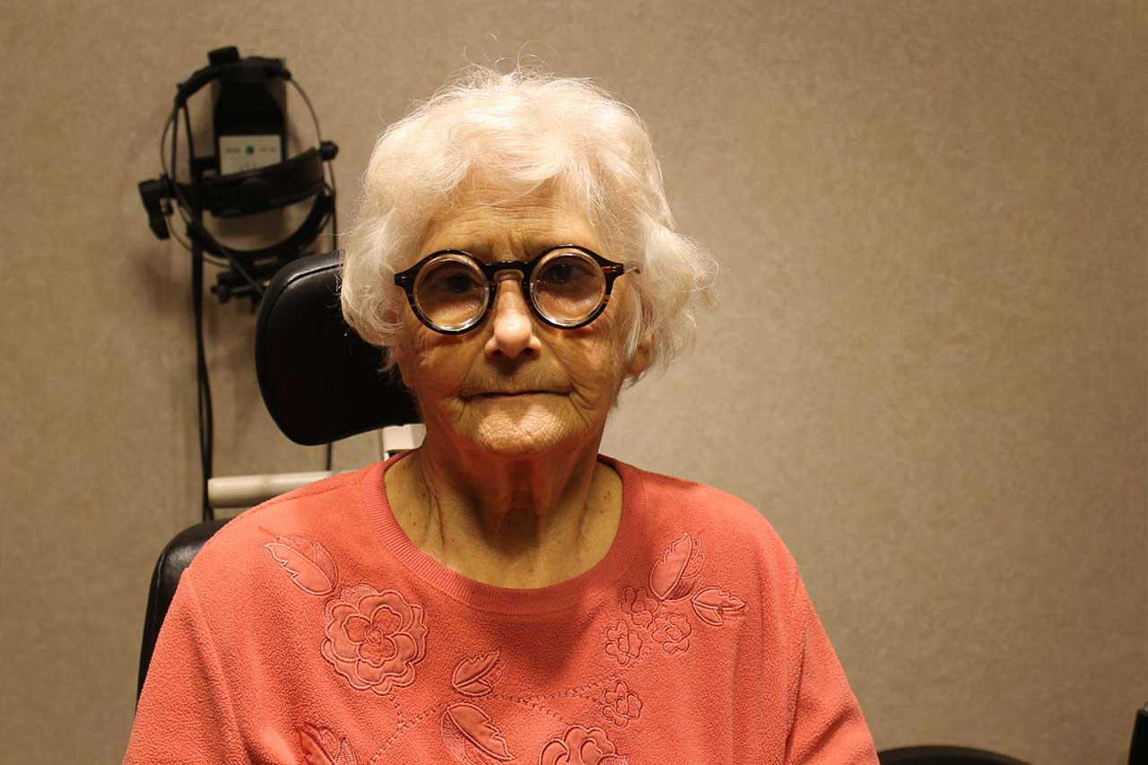 elder woman after macular degeneration treatment