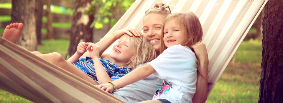 Family sitting in hammock 960×350