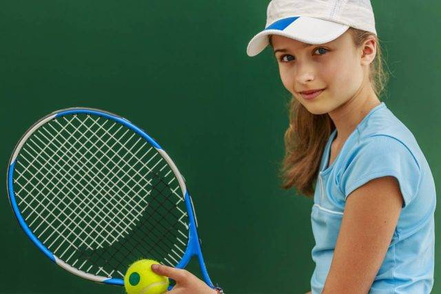 Girl playing tennis with Scleral lenses