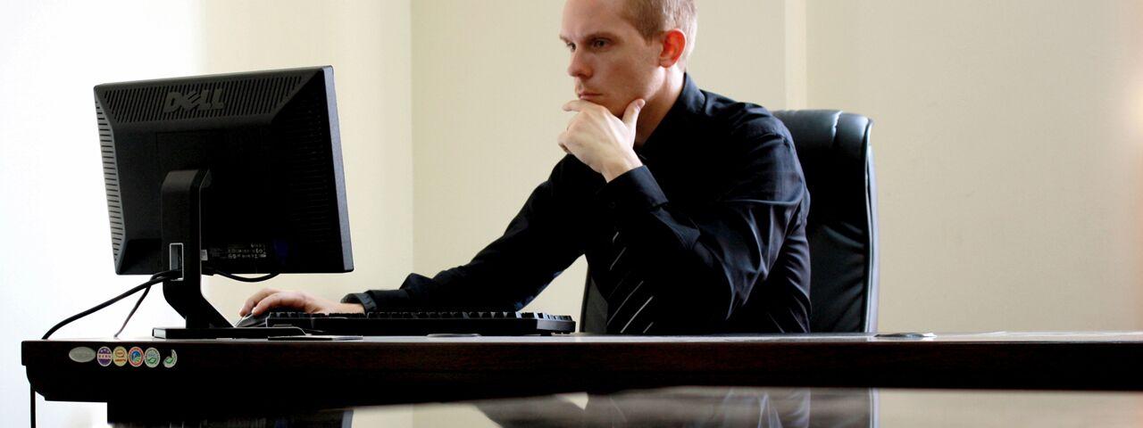 Man sitting in front of the computer in Edmonton & Sherwood Park, Alberta