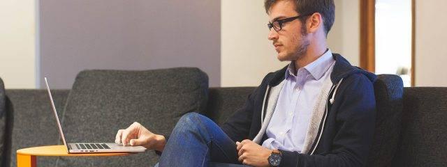 Man sitting in front of his laptop, optometrist in Billings, MT