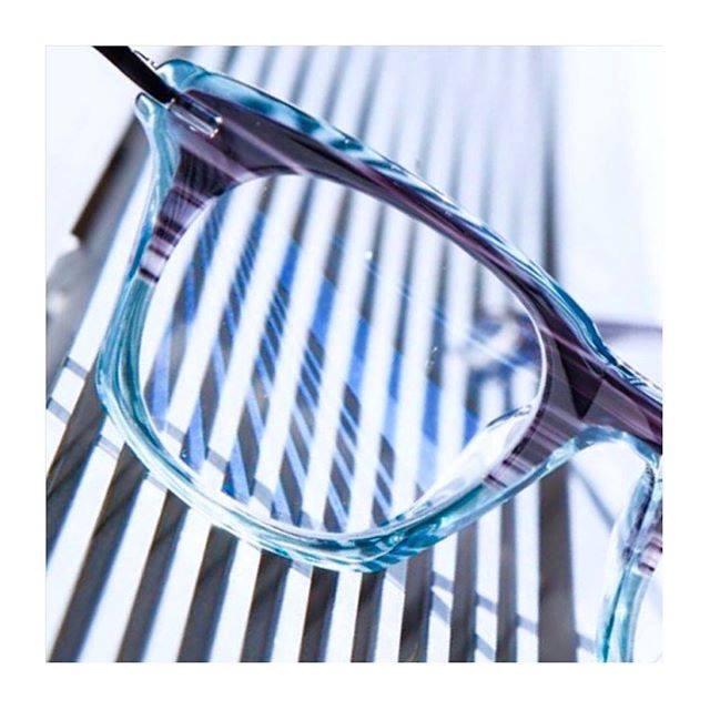 glasses on blue stripes