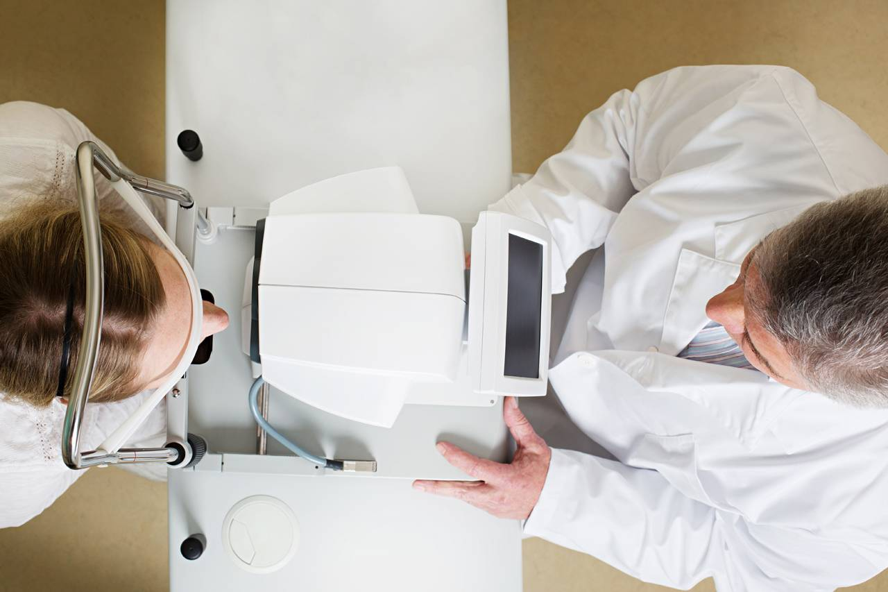 bird's eye view of eye doctor examining patient's eyes