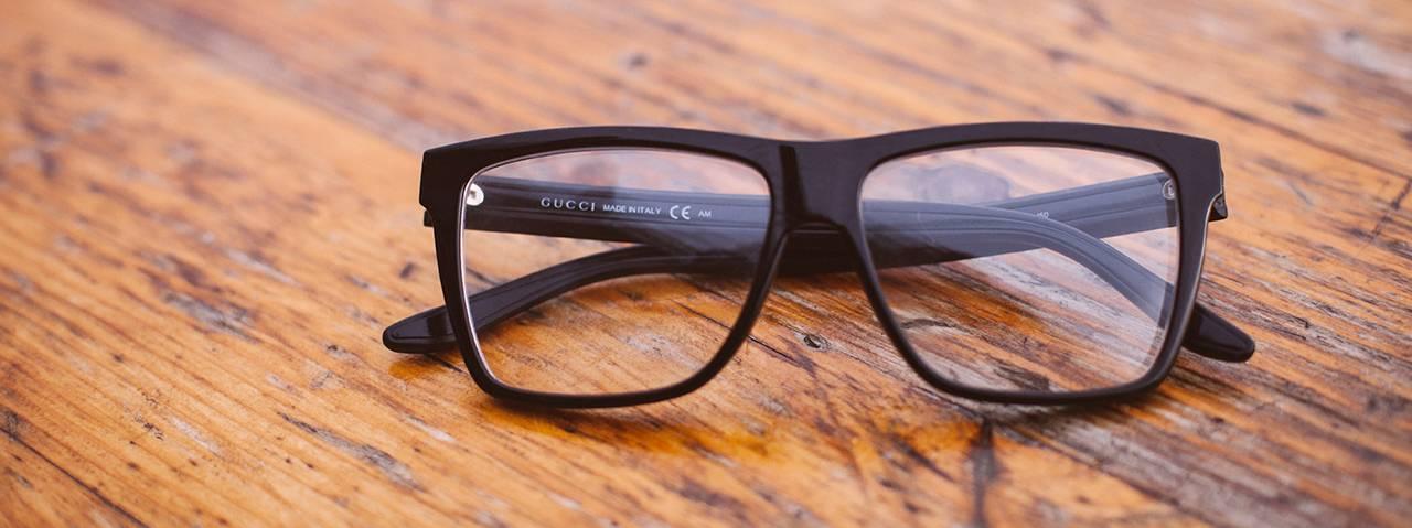 black glasses on wood table 1280x480