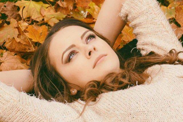 optometrist, woman with dry eye, laying in pile of leaves in Tulsa, OK