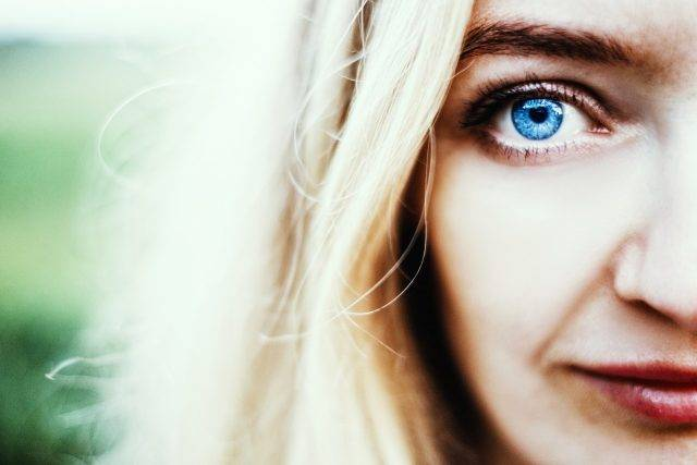 eye exam, close up of woman with blue eyes, wearing scleral lenses in Tulsa, OK