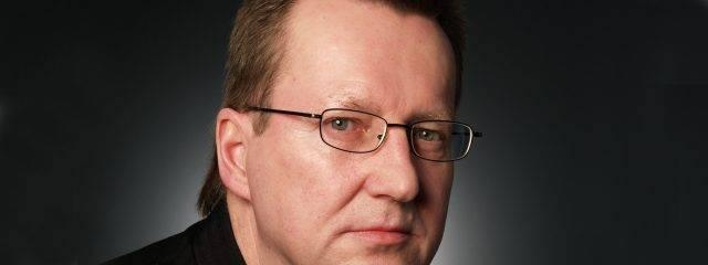 Optometrist, middle aged man wearing prescription eyeglasses in Broken Arrow, OK