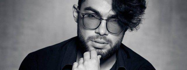 Optometrist, man wearing Transitions lenses eyeglasses in Broken Arrow, OK