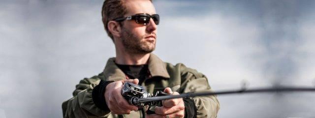Eye doctor, man fishing wearing specialty sunglasses in Broken Arrow, OK