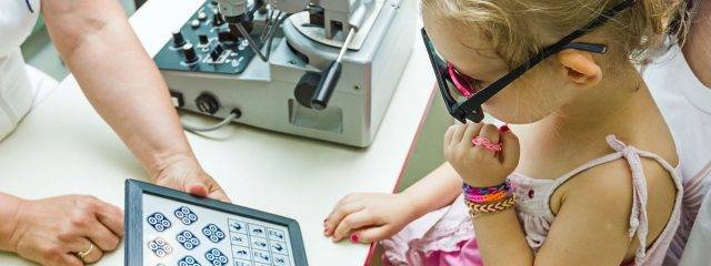 Eye doctor, little girl at vision therapy in Boston, Braintree, Burlington, Danvers, Dorchester, Leominster, Marlborough, Quincy, Worcester & Webster MA