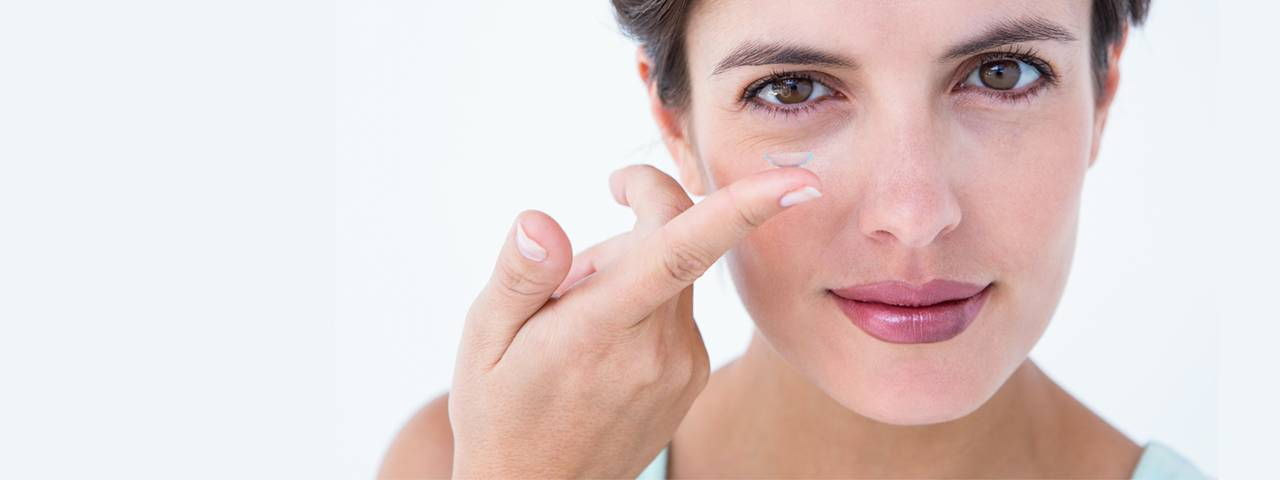 Woman Holding Contact Lens 1280×480