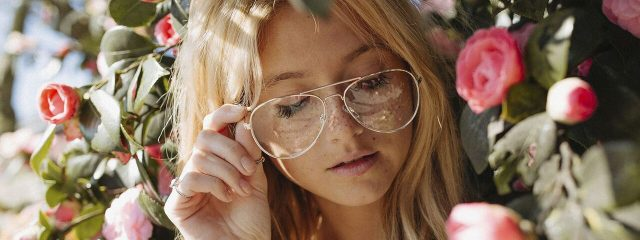 Optometrist, woman wearing designer eyeglasses in Conroe, Woodlands, Spring, Houston, TX