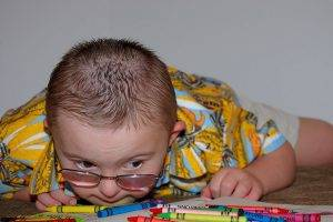 Eye doctor, special needs boy with crayons in Springs, CO