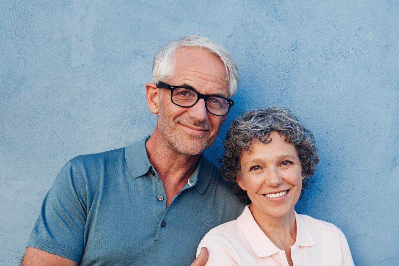 senior couple with eyeglasses, smiling