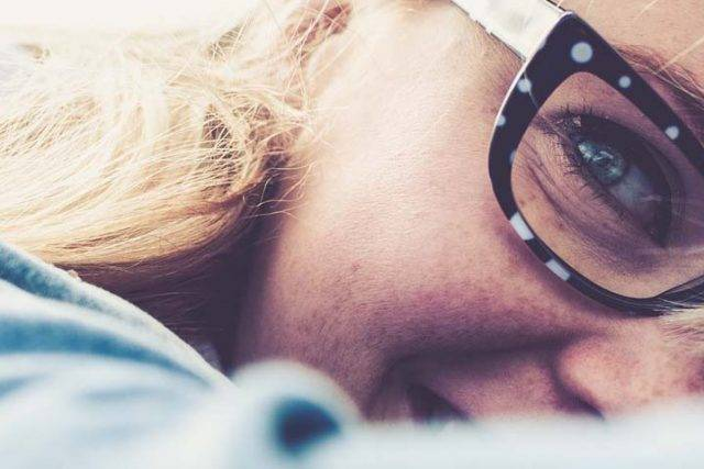 woman wearing glasses after using Hot Compress for Dry Eye