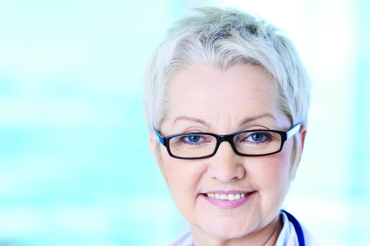 mature lady eye doctor, wearing eyeglasses