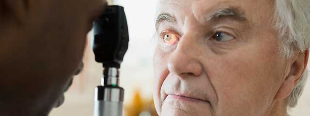 Man Having Eye Exam for Low Vision