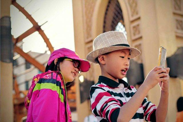 eye wear, asian kids with smartphone and dry eye  in Lewis Center, OH