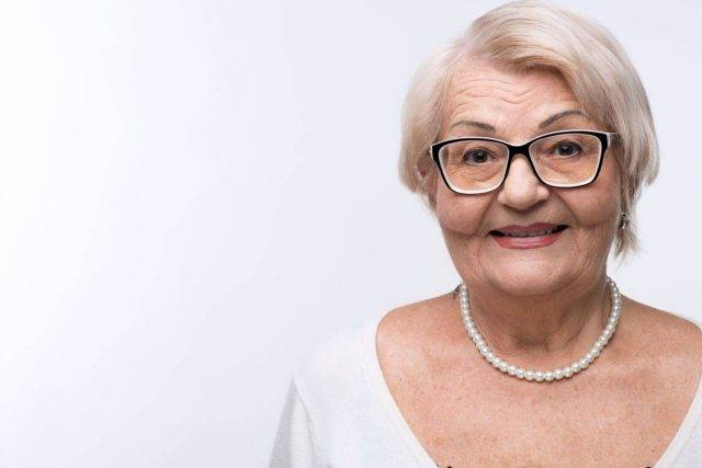 senior woman with glasses for keratoconus treatment with eye doctor in Lewis Center, OH