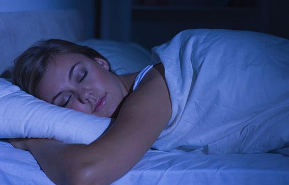 Serene woman sleeping at night