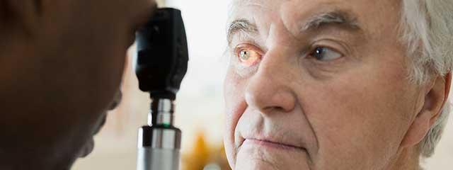 Man Having Eye Exam for Low Vision
