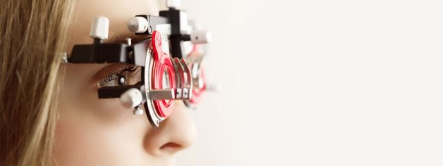 Optometrist, woman at an eye exam for contact lenses in Mississauga & Brampton, ON