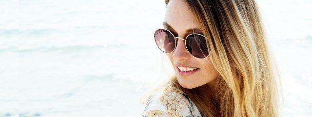 Optometrist, woman wearing sunglasses in Jacksonville, Florida